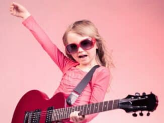 over dramatic child playing guitar