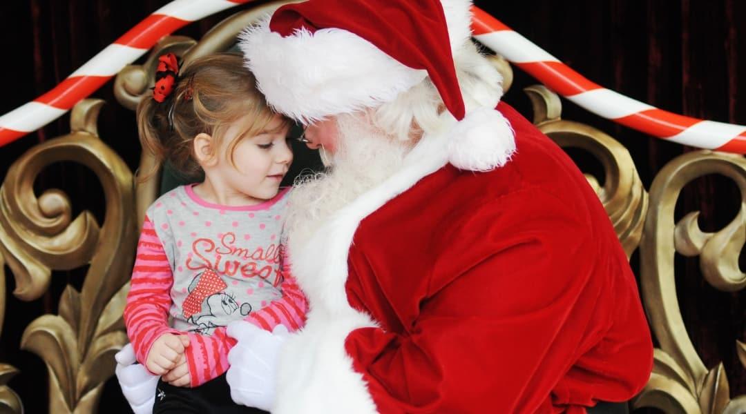 Girl talking to Santa Claus in the Magic Kingdom