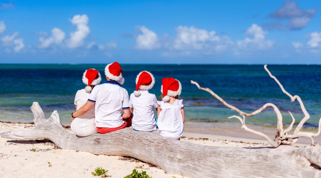 family on the beach at christmas